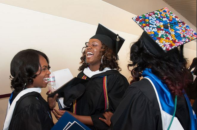 Kirby Gaddy laughs with her friends at the May 2013 commencement ceremony.